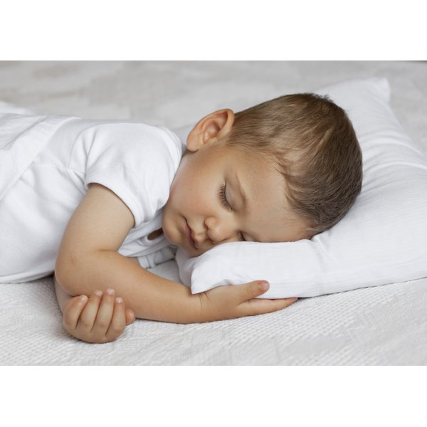 Pillow safety will help keep your toddler safe while she sleeps.