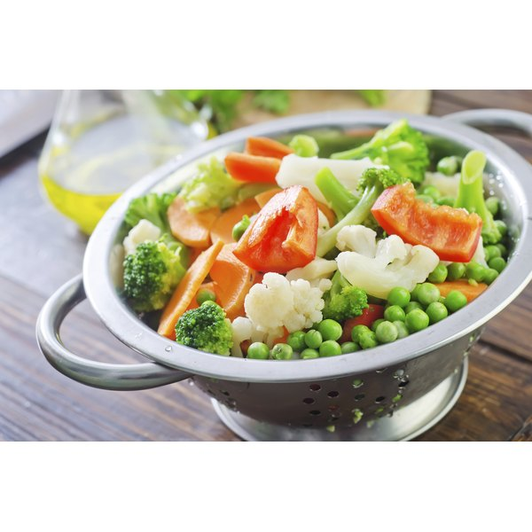 Mix steamed cabbage with other lightly cooked vegetables and dress with vinaigrette.