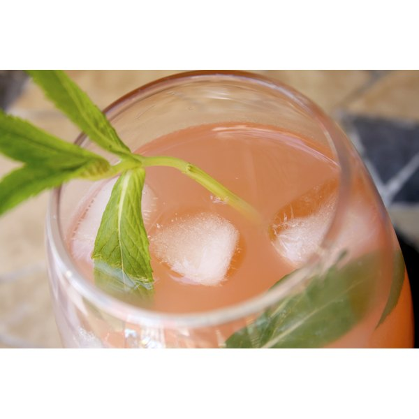 A close up of a glass of fresh guava juice with mint