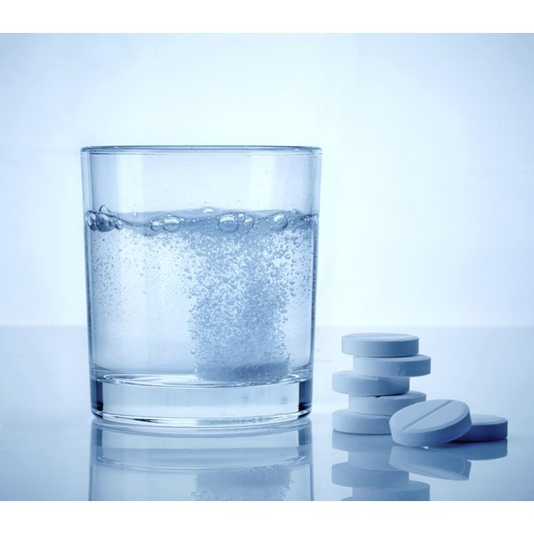 A water soluble vitamin B tablet in a glass of water.