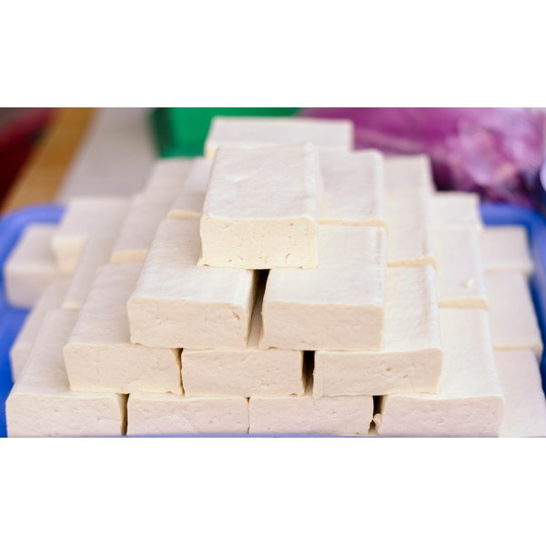 Fresh tofu blocks on a plate.