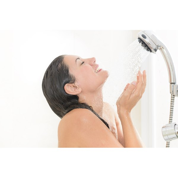 Close up of a woman taking a shower.