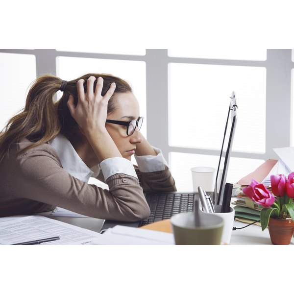 A woman is highly stressed out at work.