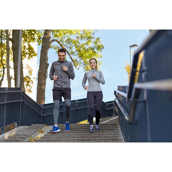 A woman and man are jogging together.