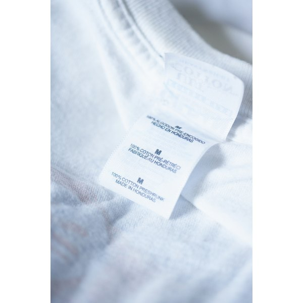 Cotton T-shirts shrink under high temperatures during both the washing and the drying cycles.