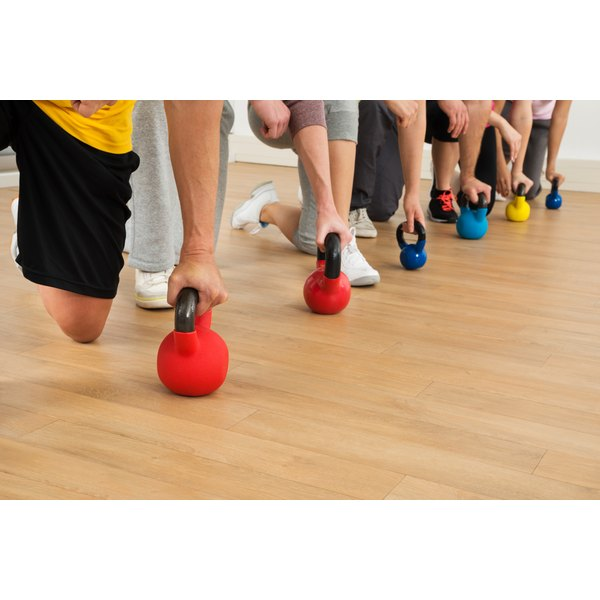 Strength training, here with kettlebells, helps prevent muscle loss while losing weight.