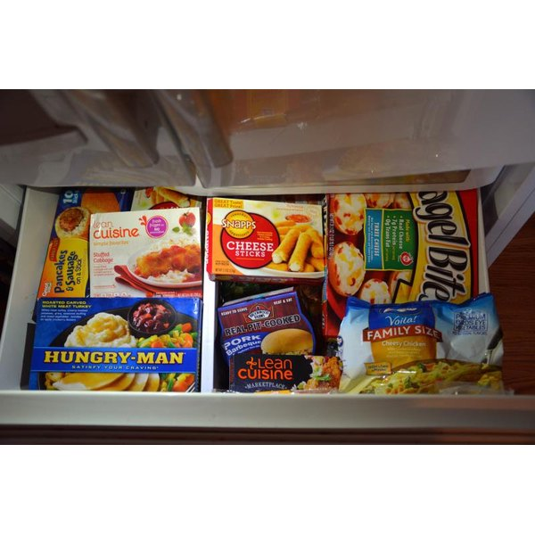 View from above of a freezer drawer with a variety of packaged frozen food.