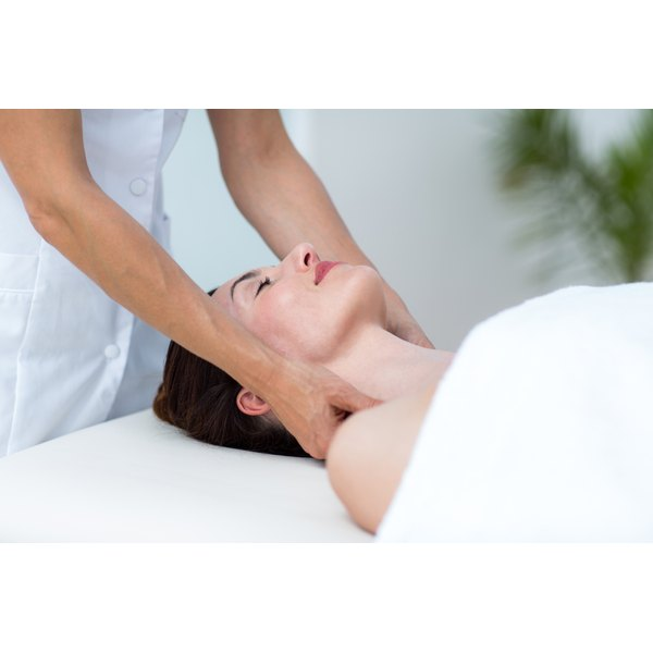 A woman is receiving a neck massage.