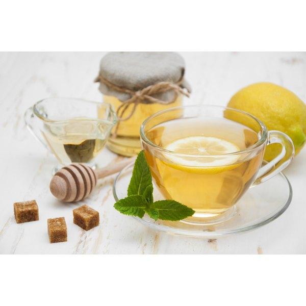 A cup of herbal tea, honey and lemon.