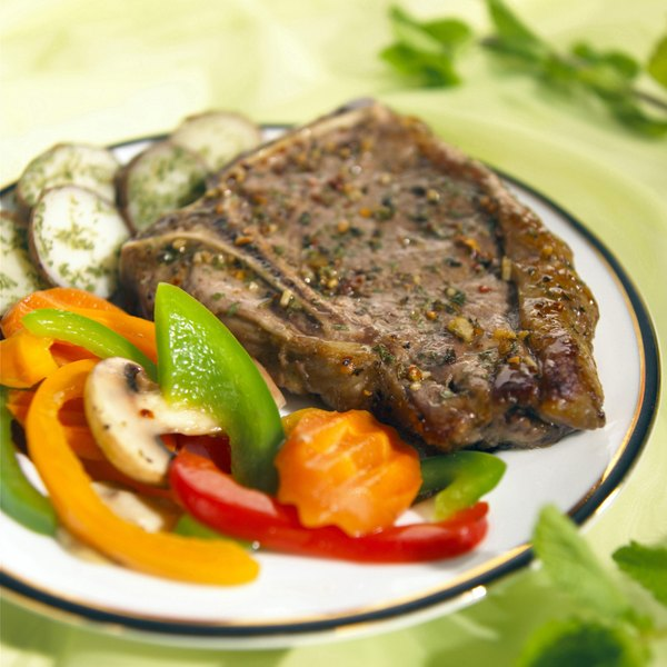 Steak with vegetables on a plate.