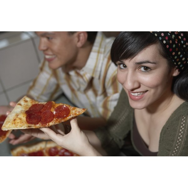 You'll save about 85 calories by having a slice of thin-crust cheese instead of regular-crust cheese.