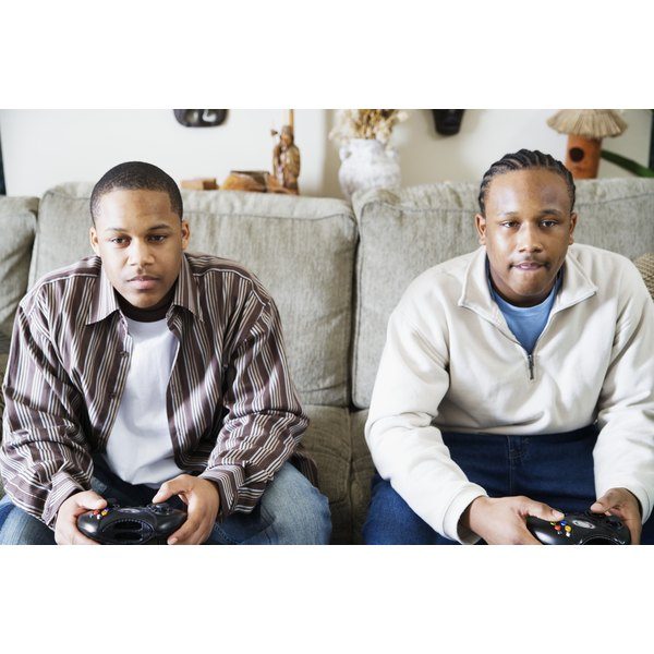 Two young men playing video games at home.