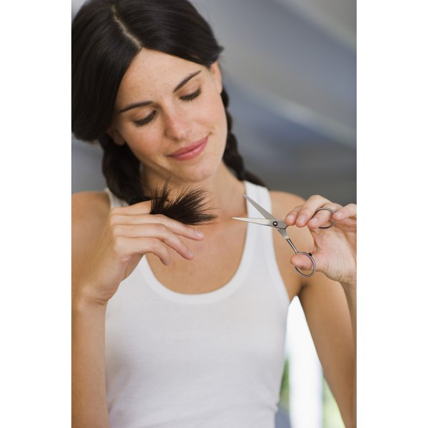 Cut split ends off yourself or visit a professional for a uniform look.