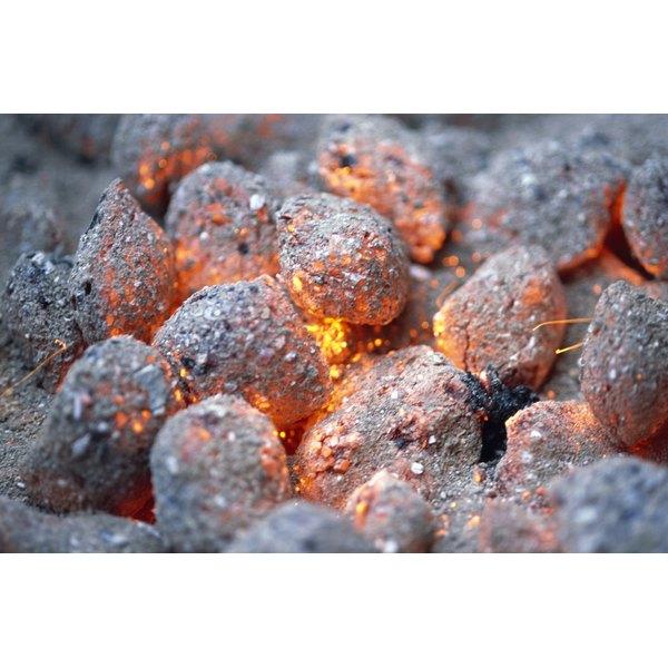 A half pig roast requires a steady temperature over a bed of coals.
