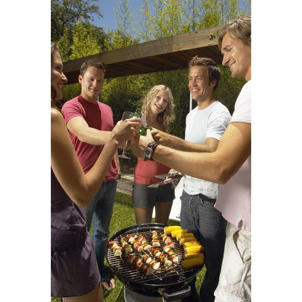 Barbecue with friends in relaxed summer fashions.