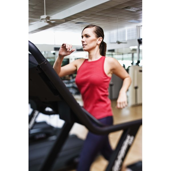 Woman walking on treadmill.