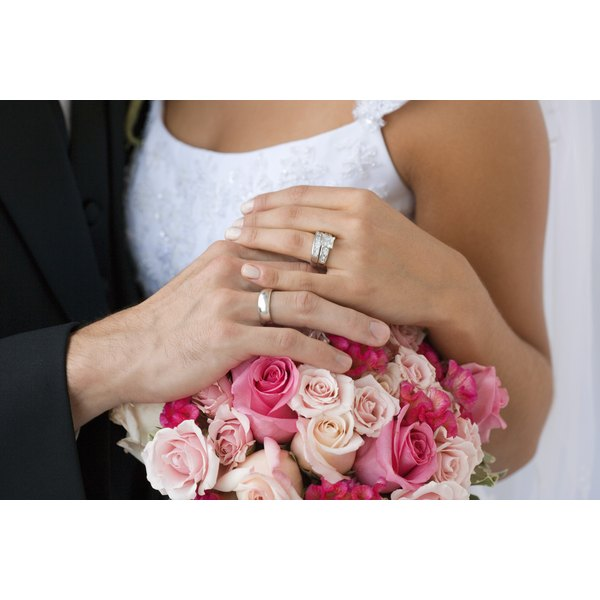 Couple wearing wedding rings