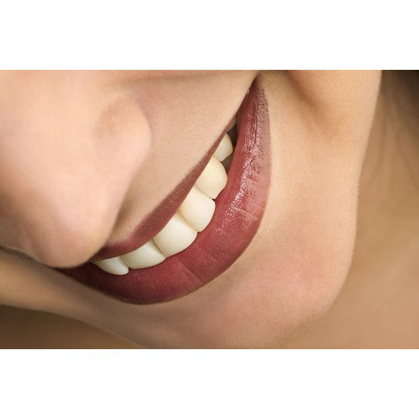 A close up of a woman's mouth with very white pretty teeth.