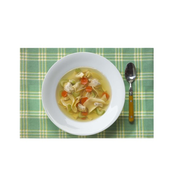 Spice up your chicken soup by adding a little Mexican spice and tortillas.