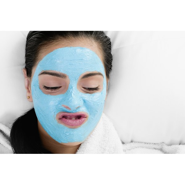 A woman is wearing a facial mask.