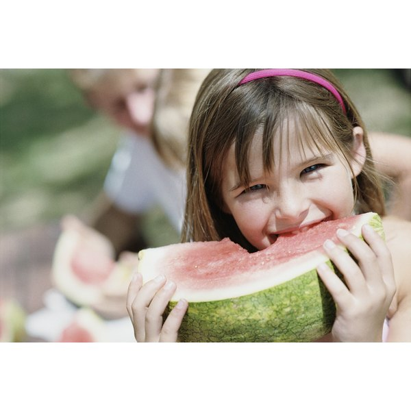 Young girl eating watermelon.
