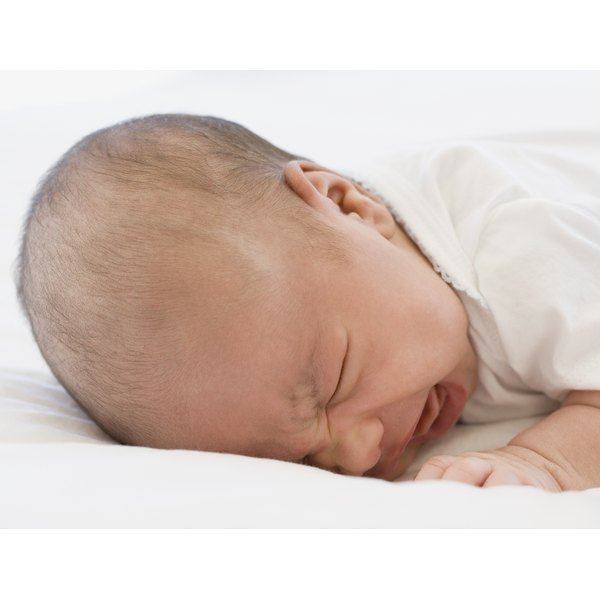 Coughing and sore throat in an infant are often due to mucus drainage.
