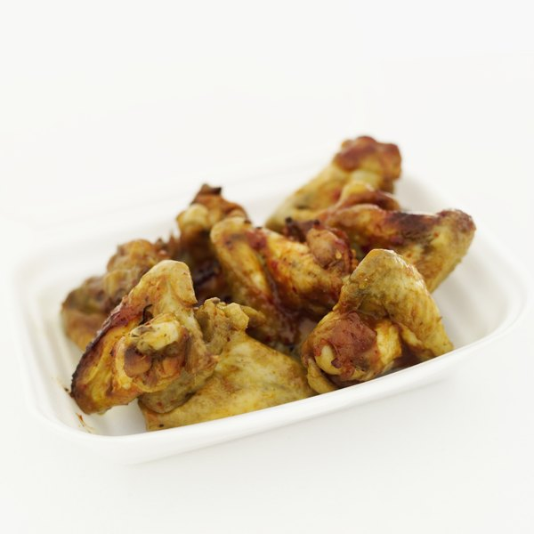 Oven-barbecued chicken wings are usually cooked whole, while fried wings are often cut into pieces.