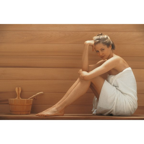 A woman is sitting in a steam room.