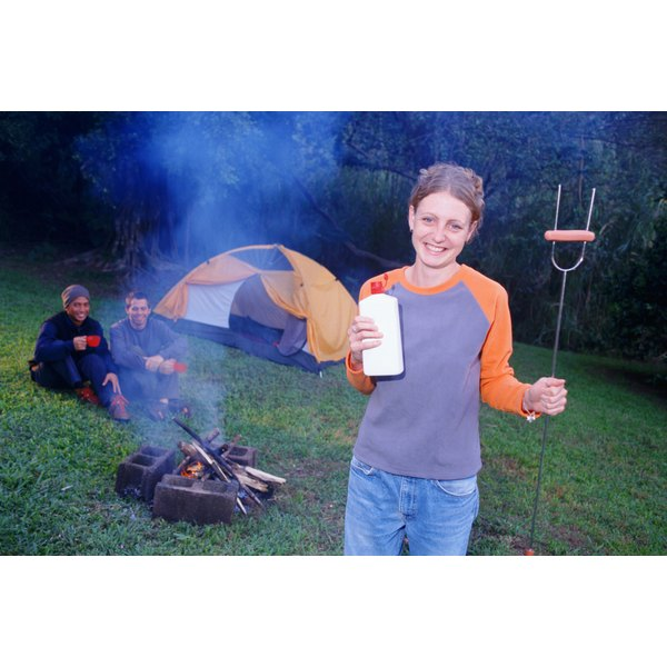 You can safely remove lighter fluid spills from clothing.