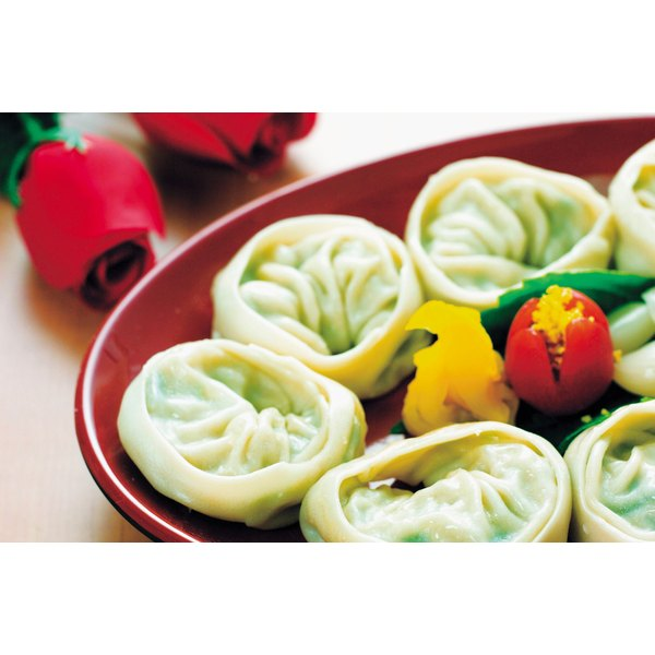Potstickers are a version of dumplings that envelop a filling.