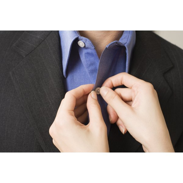 Remove wrinkles from a dress shirt with a clothes steamer.