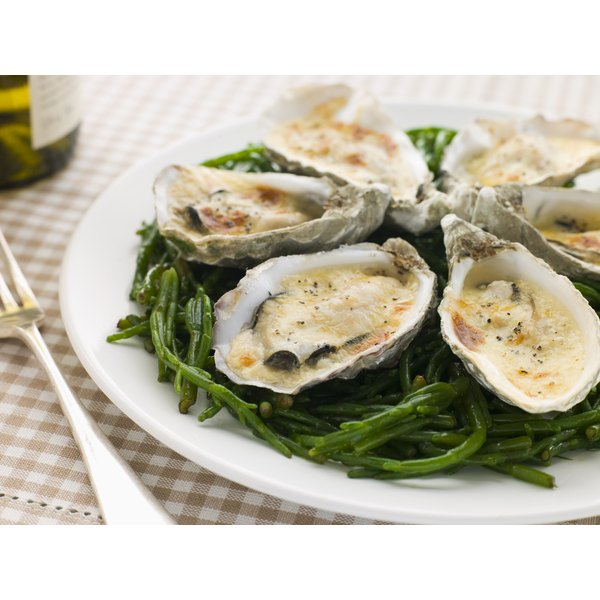 A plate of cooked oysters.