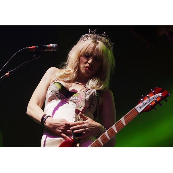 Courtney Love sports a vintage-style dress and a starry tiara for a concert in Sydney in August 2014.