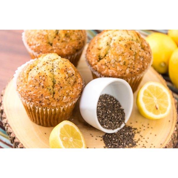 Three large lemon poppy seed muffins.