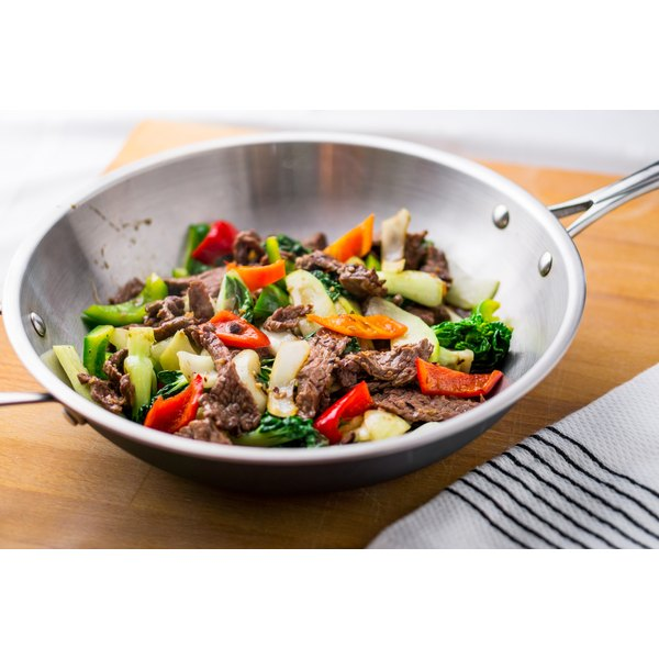 A stir-fry dish tossed up in a wok.