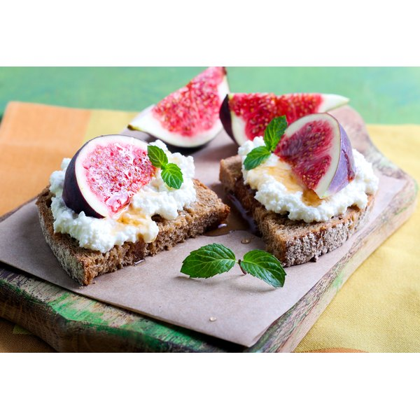 Ricotta cheese topped with figs and honey on whole grain bread.