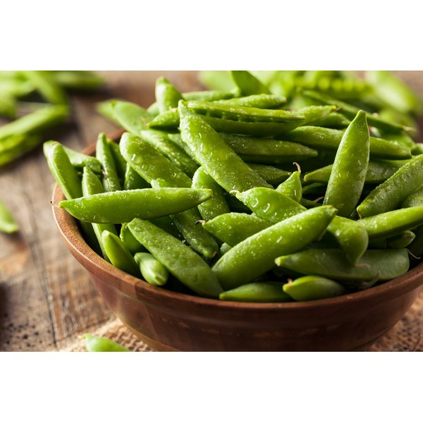 Sugar snap pea pods in a bowl.