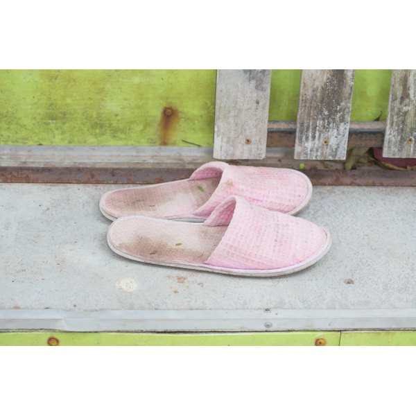 Pink fleece slippers that are dingy.