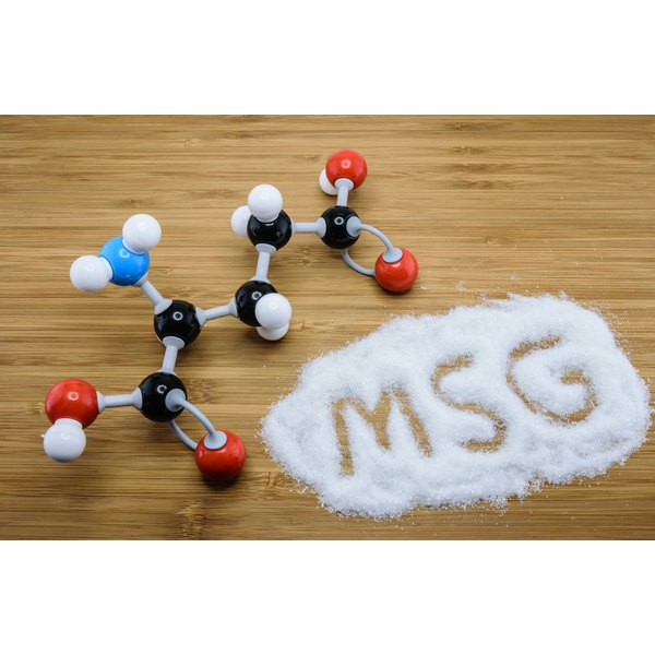 Molecule model of glutamate next to MSG written in glutamate powder