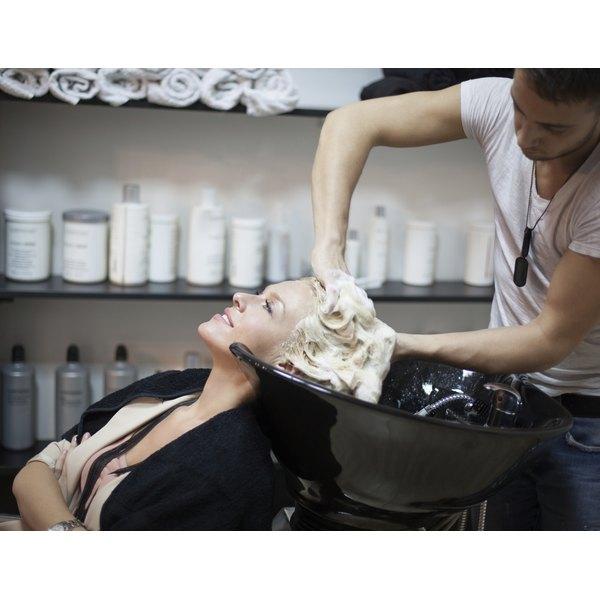 A woman having her hair shampooed in a salon.