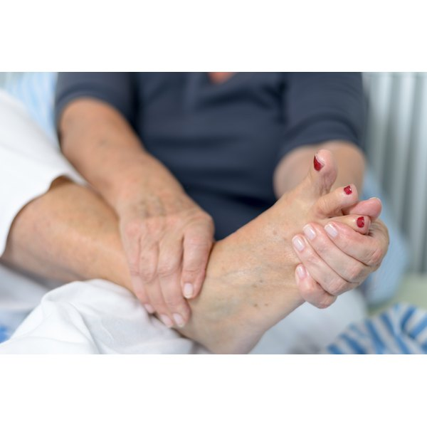 Woman rubbing her foot
