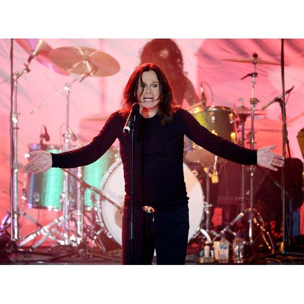 Ozzy Osbourne singing on stage.