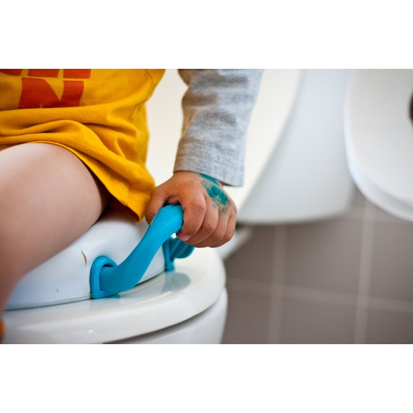 Close-up of a toddler on a potty.
