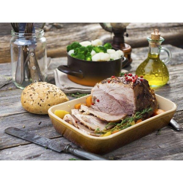 A large, sliced pork roast on a table.