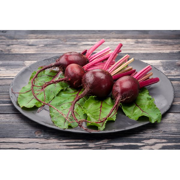 A large plate with raw beets.