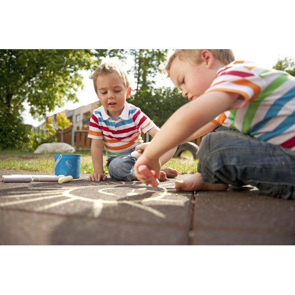 Use playtime and simple activities to teach your children about cooperative play.
