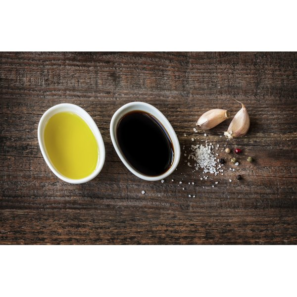 A basic vinaigrette contains olive oil, balsamic vinegar, salt, pepper and garlic.