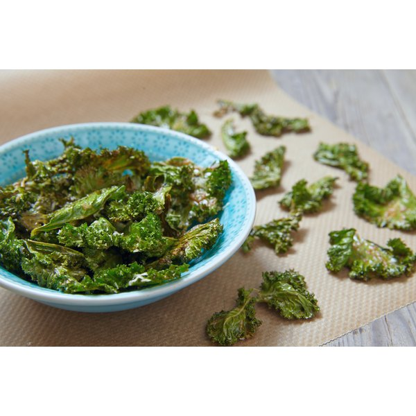 A bowl of crispy baked kale leaves.