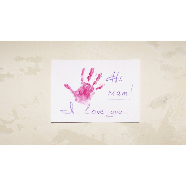 Child's hand print on a piece of paper.
