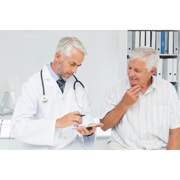 Doctor consulting with a senior man